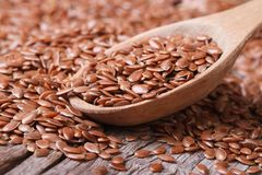 Flax seeds close up on a wooden spoon on a table Stock Photography