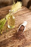 Flax seeds and flax oil on old wooden board Stock Images
