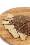 Flax seeds with flax snacks on the board Royalty Free Stock Image