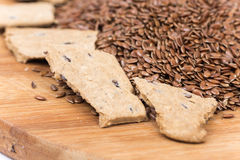 Flax seeds with flax snacks on the board Stock Photography