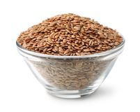 Flax seeds in glass bowl Stock Image