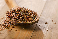 Flax seeds heap on  wooden spoon Royalty Free Stock Photos