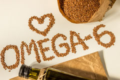 Flax seeds, linseed oil in the bottle. Healthy eating. Royalty Free Stock Photography