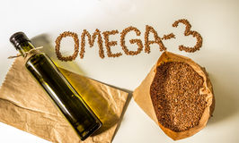 Flax seeds, linseed oil in the bottle. Healthy eating. Royalty Free Stock Photo