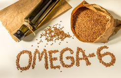 Flax seeds, linseed oil in the bottle. Healthy eating. Royalty Free Stock Images