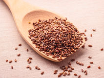 Flax seeds linseed on wooden spoon Stock Photos