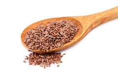 Flax seeds, linseeds on a wooden spoon Royalty Free Stock Images