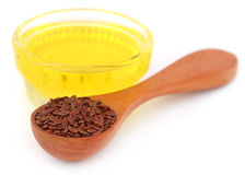 Flax seeds with oil Stock Images