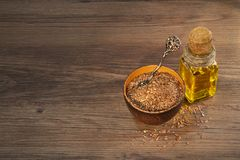 Flax seeds and oil stock image