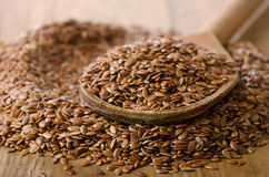 Flax seeds on a old  wooden spoon. Royalty Free Stock Photos