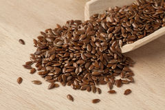 Flax seeds. Scoop with brown flax seeds stock photography