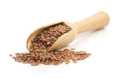Flax seeds in scoop on white Stock Image