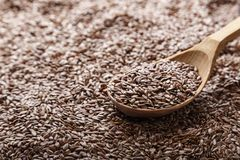 Flax seeds in a spoon. Top view stock photography