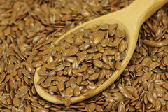 Flax seeds in a spoon  background Stock Image