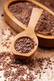 Flax seeds in spoon Royalty Free Stock Images