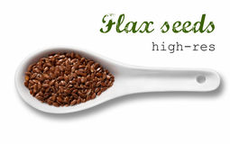 Flax seeds in white porcelain spoon Royalty Free Stock Photo