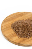 Flax seeds on the wooden board Royalty Free Stock Photos