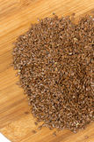 Flax seeds on the wooden board Stock Photo