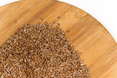 Flax seeds on the wooden board Stock Images