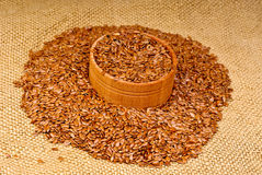 The flax seeds in a wooden bowl Stock Image