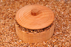 The flax seeds in a wooden bowl Royalty Free Stock Photography