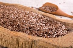 Flax seeds in wooden bowl royalty free stock image