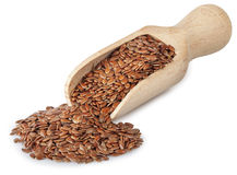 Flax seeds in wooden scoop  on white Stock Photography