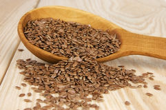 Flax seeds. In wooden spoon stock photos