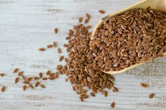 Flax seeds in wooden spoon royalty free stock images
