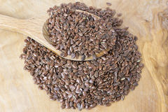 Flax seeds with a wooden spoon Royalty Free Stock Image