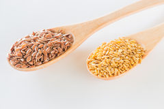 Flax seeds on wooden spoon Royalty Free Stock Photos