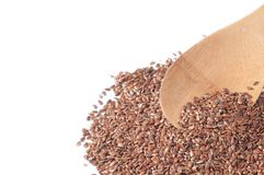 Flax seeds with a wooden spoon on white background Stock Images