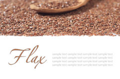 Flax seeds with a wooden spoon on white background Stock Photo