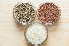 Flax, sesame, and cannabis seeds in glass bowls Stock Photography