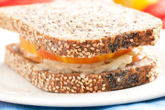 Flax and sunflower seed bread with heirloom tomato and cheese Stock Photo
