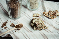 Flaxen bars with sunflower seeds, sesame seeds and spices, healt. Hy snack crackers on a bright towel Royalty Free Stock Photo