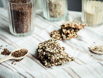 Flaxen bars with sunflower seeds, sesame seeds and spices, healt. Hy snack crackers on a bright towel Stock Image