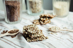 Flaxen bars with sunflower seeds, sesame seeds and spices, healt. Hy snack crackers on a bright towel Stock Photography