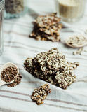 Flaxen bars with sunflower seeds, sesame seeds and spices, healt. Hy snack crackers on a bright towel Stock Images