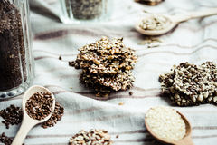 Flaxen bars with sunflower seeds, sesame seeds and spices, healt. Hy snack crackers on a bright towel Royalty Free Stock Images