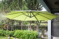 Flaxen garden umbrella in summer. Stock photo Stock Image