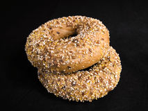 Flaxseed Bagels. Two Flaxseed Bagels on Black Fabric Background stock photo
