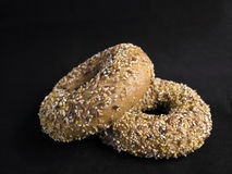 Flaxseed Bagels. Two Healthy Flaxseed Bagels on Black Fabric Background royalty free stock photography