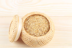 Flaxseed in basket Stock Photography