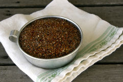 Flaxseed in Cup Stock Images
