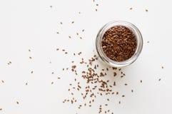 Flaxseed i exponeringsglas Royaltyfri Foto