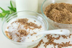 Flaxseed with milk in a bowl Stock Photos