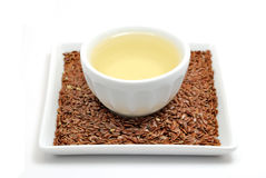 Flaxseed with oil Royalty Free Stock Photos
