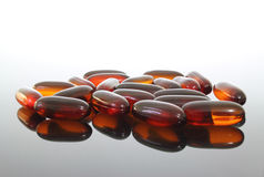 Flaxseed Oil Pills. A group of flaxseed oil pills on a glass table Stock Images