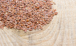 Flaxseed on wood background Royalty Free Stock Photo